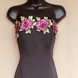 Beautiful black dress with purple flower design
